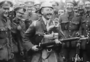 """A Dublin Fusilier shows off German """"trophies"""" acquired in battle in """"With the North and South Irish at the Front"""". Courtesy of the Trustees of the Imperial War Museum."""